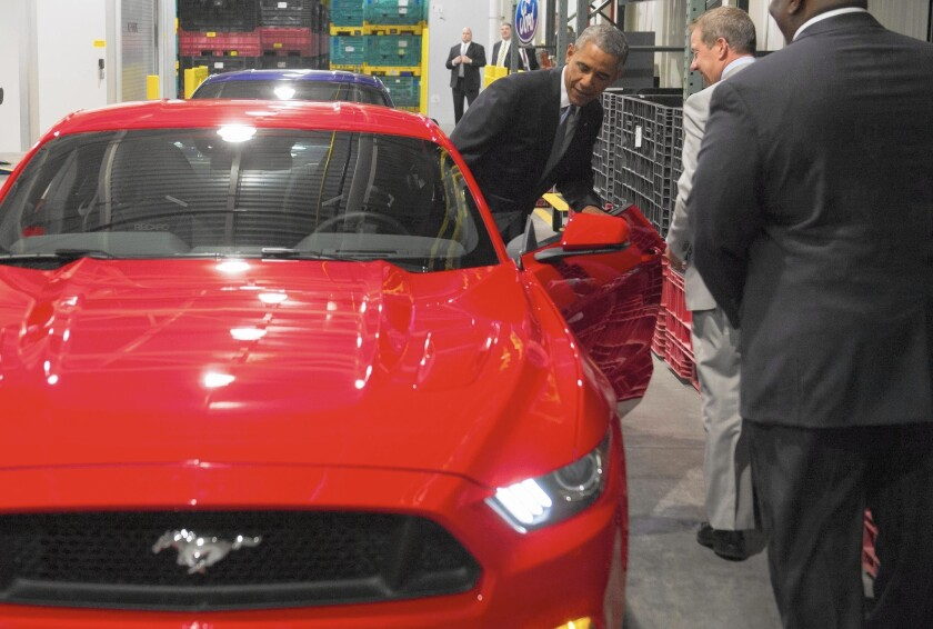 President Obama checks out a Mustang before speaking on the auto industry and U.S. economy at Ford's Michigan Assembly Plant in Wayne, Mich.