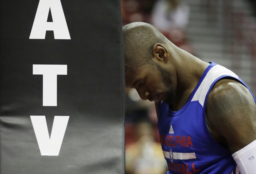 Philadelphia 76ers' Brandon Paul reacts after committing a foul against the Brooklyn Nets during the first half of an NBA summer league basketball game Thursday, July 14, 2016, in Las Vegas. (AP Photo/John Locher)