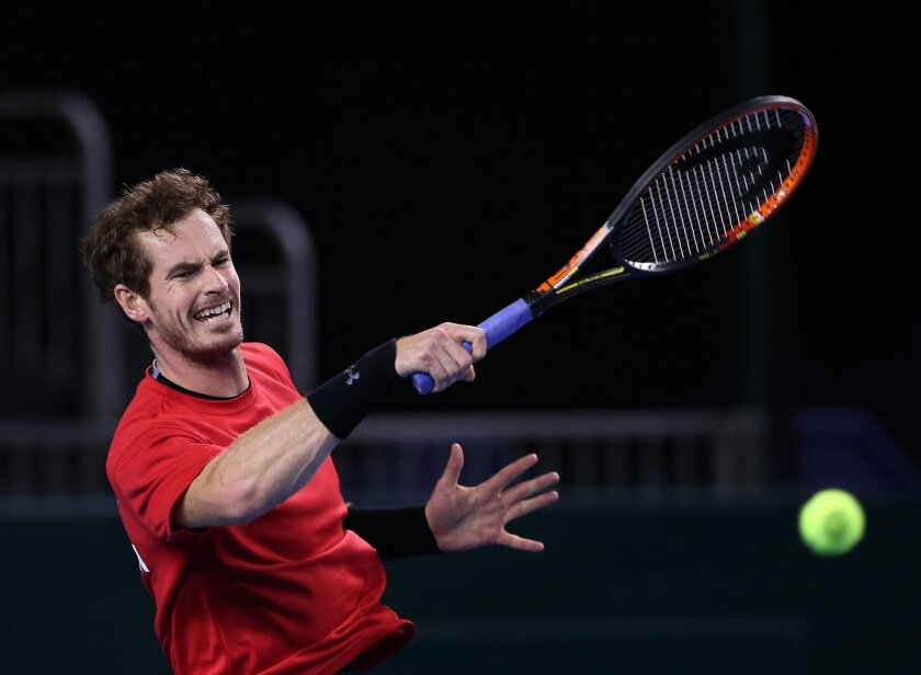 Britain's Andy Murray plays a shot during a practice session ahead of the Davis Cup semifinal tennis matches against Australia in Glasgow Scotland Thursday Sept. 17, 2015. (AP Photo/Scott Heppell)
