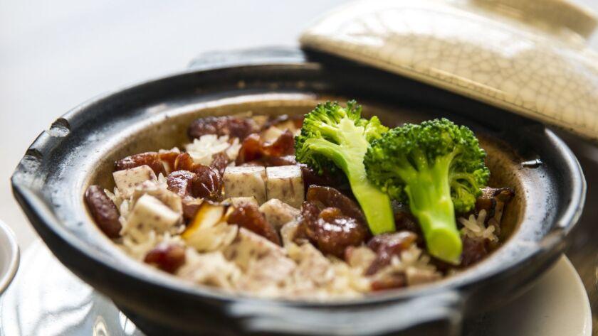 SAN GABRIEL, CALIF. - MARCH 08: The dish, Taro with lap cheong (Chinese sausage), clay pot rice, pho
