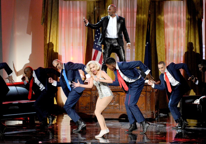 R. Kelly and Lady Gaga perform during the American Music Awards at Nokia Theatre L.A. Live on Nov. 24, 2013, in Los Angeles.