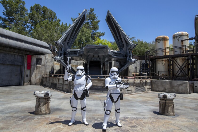 Storm Troopers patrol the First Order Outpost where the Tie Echelon fighter ship is parked at the Disneyland Resort in Anaheim.