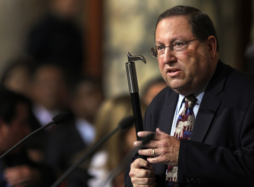 Los Angeles City Councilman Paul Koretz, holding a bullhook in 2013, as he argued for a ban on such implements to train or control elephants.