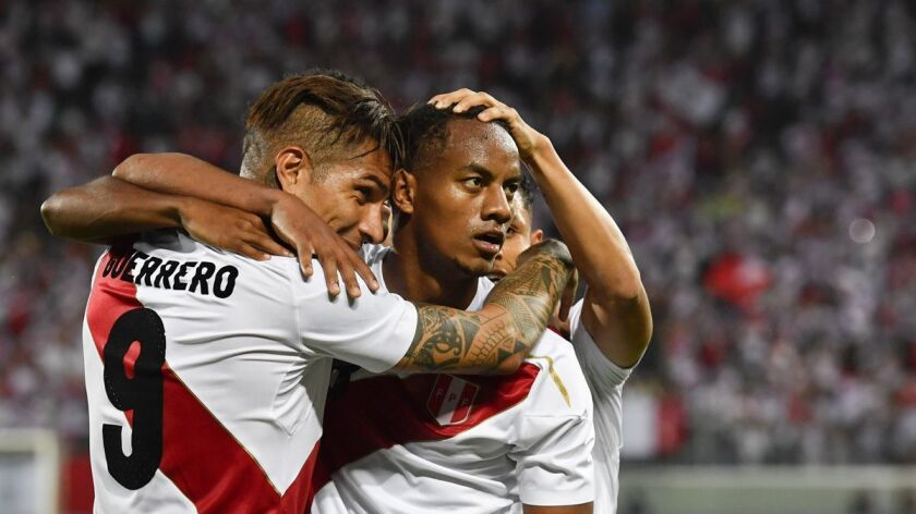 Peru's Paolo Guerrero, and Andre Carrillo, from left, react after Guerrero scored during a friendly