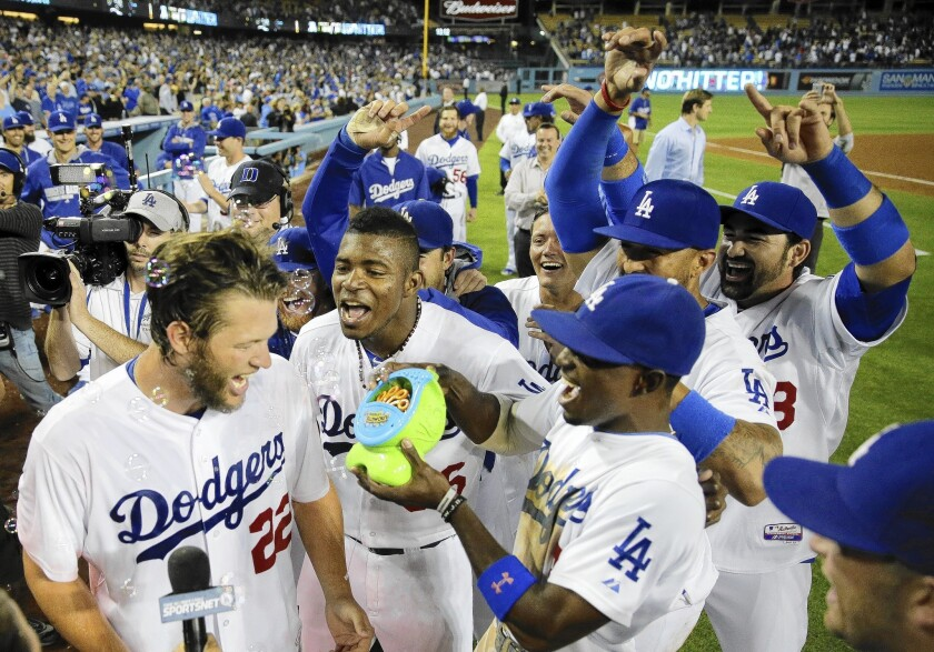 Los Angeles Dodgers pitcher Clayton Kershaw, left, celebrates his no-hitter against the Colorado Rockies with his teammates.