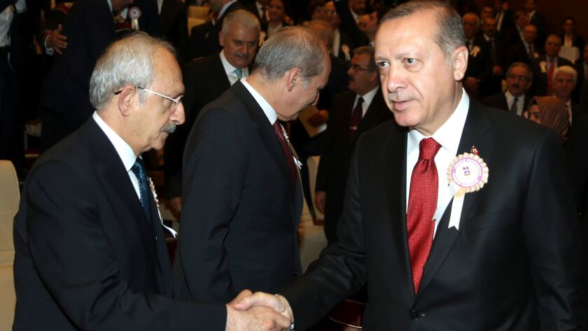 Turkey's President Recep Tayyip Erdogan, right, greets Kemal Kilicdaroglu, head of the Republican People's Party, at the anniversary celebration of the Council of State in Ankara on May 10, 2017.