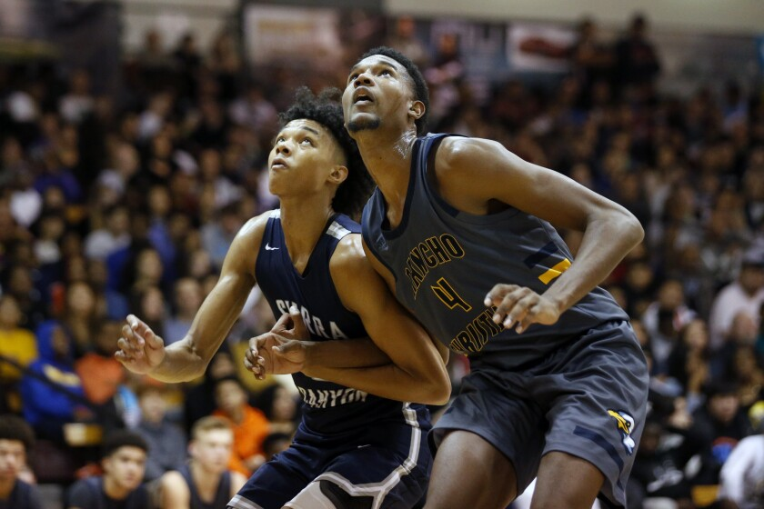 Sierra Canyon's Brandon Boston Jr. and Rancho Christian's Evan Mobley battle for position on Jan. 11 during the Elite Invitational basketball tournament at Pasadena City College.