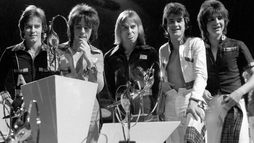 """The Bay City Rollers appear at London Weekend Television's """"Saturday Scene"""" British Pop Awards in November 1975. Alan Longmuir, left, a founding member of the group, has died in Scotland."""