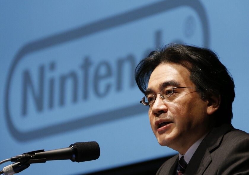 "FILE - In this Jan. 31, 2013, file photo, then Nintendo Co. President Satoru Iwata speaks during a news conference in Tokyo. Nintendo's late president Iwata oversaw the video-game maker's global growth, helping make Super Mario and Pokemon household names. ""Ask Iwata"" was published after his death from cancer in 2015 at 55 and an English translation of the book is being published in April, 2021, by VIZ Media. (AP Photo/Koji Sasahara, File)"