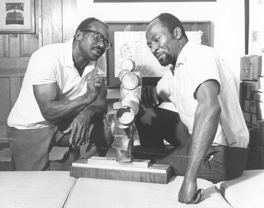 Local activists and educators Noah Purifoy and Judson Powell in the the Watts Towers Art Center in 1966.