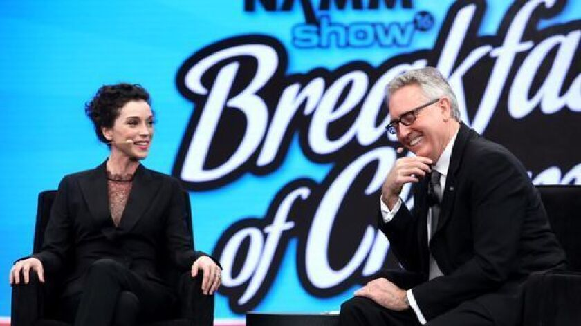 Musician Annie Clark, whose stage name is St. Vincent, is interviewed by National Association of Music Merchants' honcho Joe Lamond at the 2016 NAMM Show's opening day at the Anaheim Convention Center.