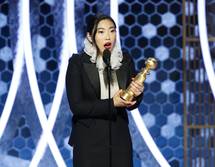 """This image released by NBC shows Awkwafina accepting the award for best actress in a motion picture comedy for her role in """"The Farewell"""" at the 77th Annual Golden Globe Awards at the Beverly Hilton Hotel in Beverly Hills, Calif., on Sunday, Jan. 5, 2020. (Paul Drinkwater/NBC via AP)"""