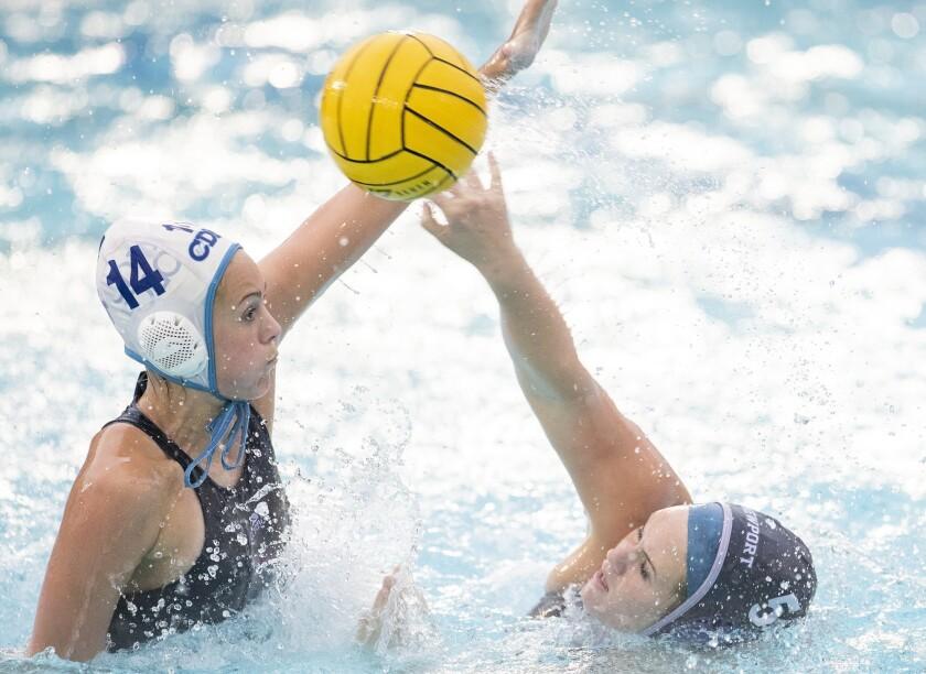 Corona del Mar's Megan Peterson attempts to block Newport Harbor's Linnea Kelly during a Surf League