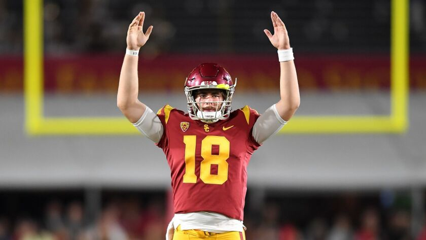 LOS ANGELES, SEPTEMBER 21, 2018-USC quarterback J.T. Daniels signals touchdown on a catch by Michael