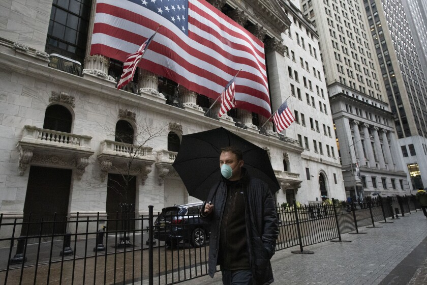 A man walks by the New York Stock Exchange on Tuesday.