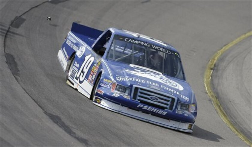 Ross Chastain races his car during the NASCAR Truck Series auto race, Sunday, Sept. 8, 2013, at Iowa Speedway in Newton, Iowa. (AP Photo/Charlie Neibergall)