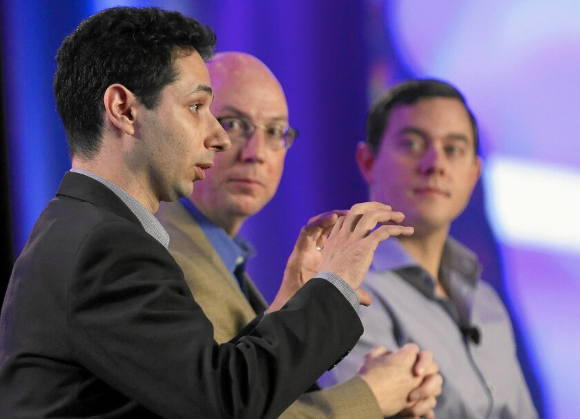 "Gil Litichever, left, Chris Valasek and Michael Cammisa participate in ""Automotive Cybersecurity: A Frank Discussion"" at the L.A. Auto Show last year. Hacking ""takes a lot of resources, money, and you have to be an expert,"" Valasek said. ""I am not concerned that someone will take over my car."""