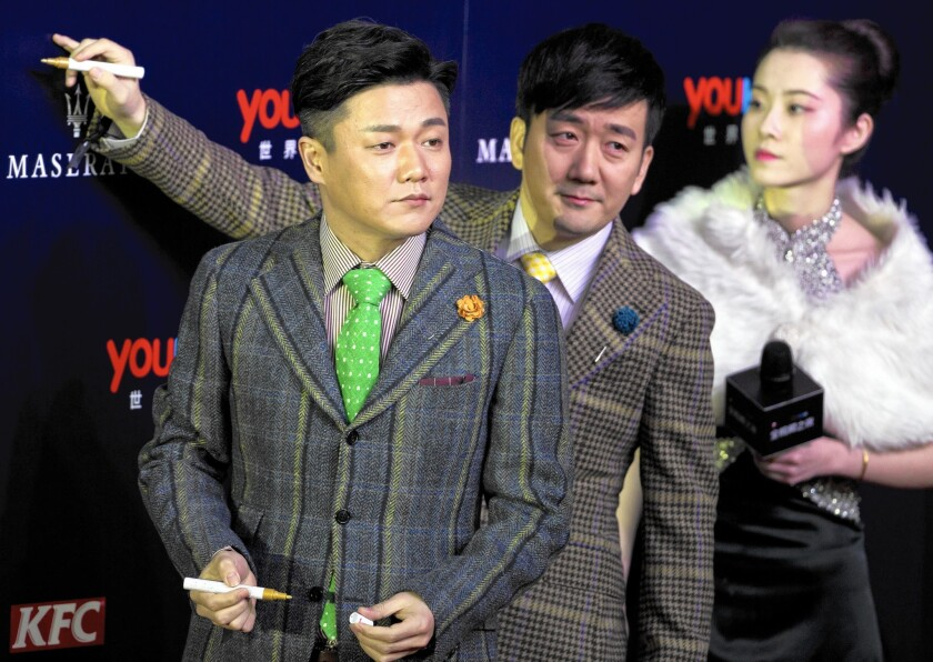 """Chopstick Brothers Xiao Yang, left, and Wang Taili created the song """"Little Apple"""" for the film """"Old Boys: The Way of the Dragon,"""" but the song's video has surpassed the film in popularity."""