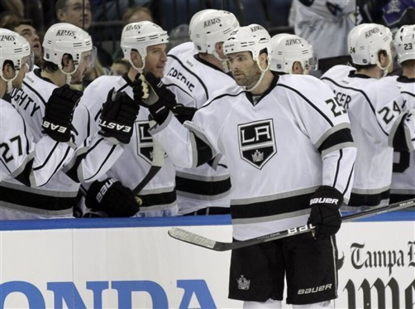Los Angeles Kings left wing Dustin Penner (25) celebrates with the bench after his goal against the Tampa Bay Lightning during the second period of an NHL hockey game Tuesday, Feb. 7, 2012, in Tampa, Fla. (AP Photo/Chris O'Meara)
