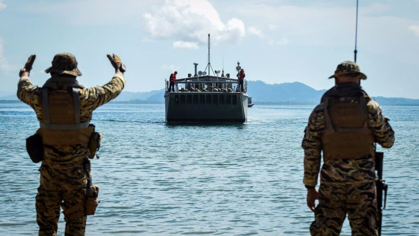 Philippine special forces guide an amphibious landing craft on a beach on May 15, 2017, in Casiguran