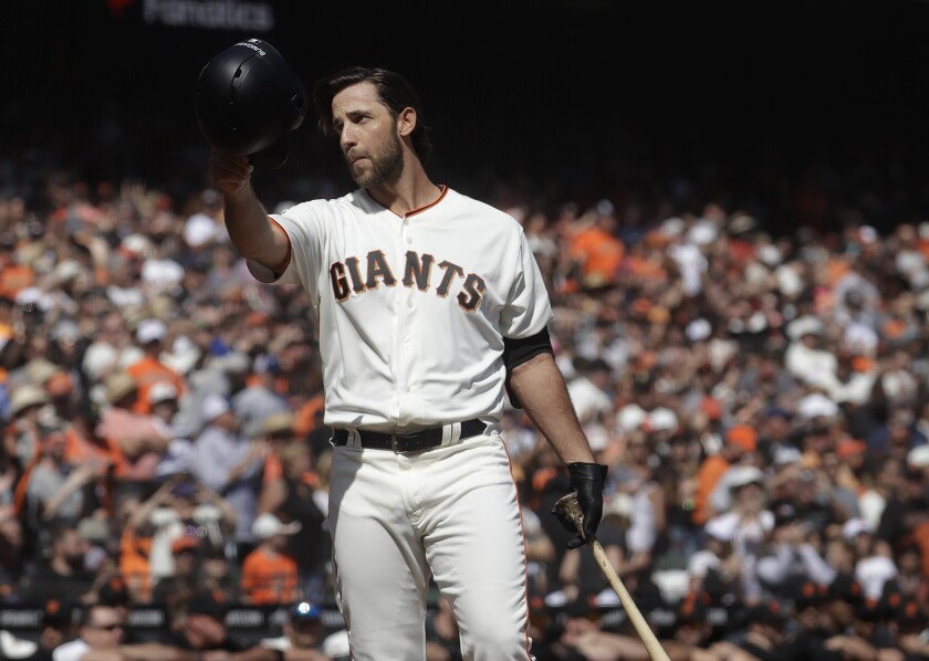 FILE - In this Sunday, Sept. 29, 2019, file photo, San Francisco Giants' Madison Bumgarner waves toward fans before pinch hitting against the Los Angeles Dodgers during the fifth inning of a baseball game in San Francisco. The Giants plan to meet with the free agent left-hander's representatives during the December 2019 baseball winter meetings in San Diego. (AP Photo/Jeff Chiu, File)