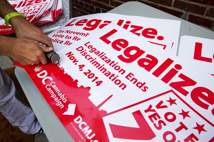 Shown are posters from the successful 2014 campaign that encouraged Washington residents to legalize small amounts of marijuana for personal use.