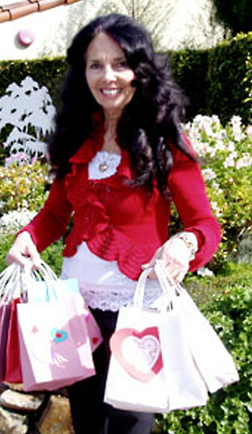 Friends Vice President Teri Summerhays with some gift bags for the students. Courtesy photo