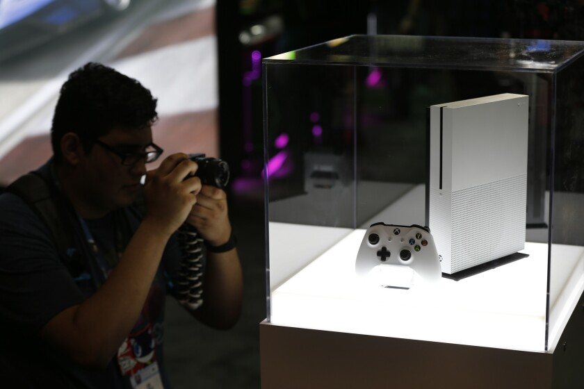 A photographer gets a view of the new Microsoft Xbox One S game console.