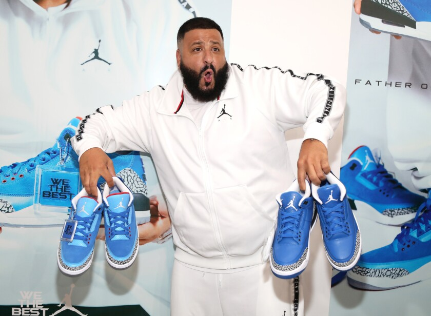 DJ Khaled unveils the efforts of his Jordan Brand footwear collaboration — the Father of Asahd III, left, and Another One III sneakers — during a recent appearance in Los Angeles.
