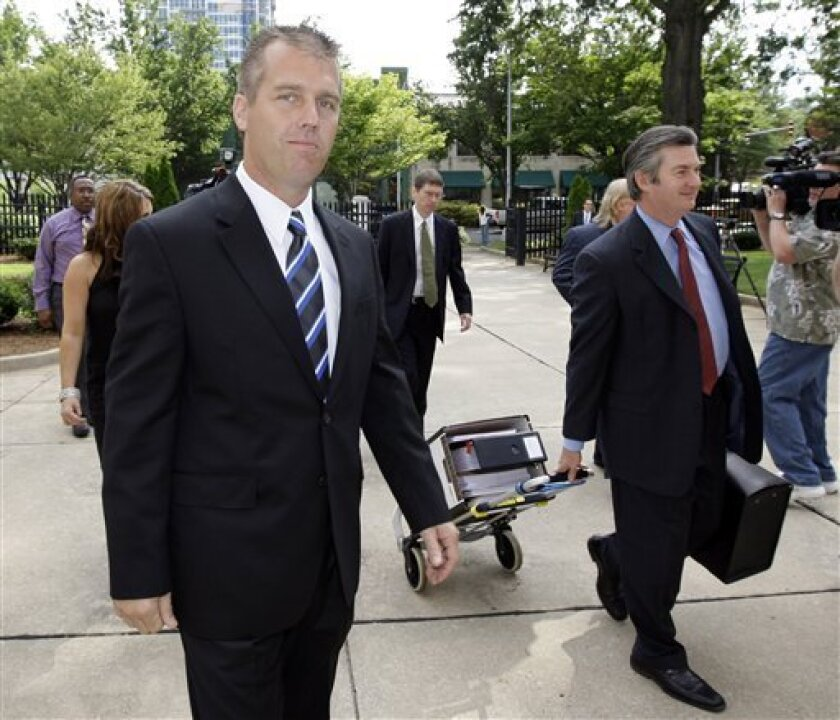 NASCAR driver Jeremy Mayfield, left, arrives at the Federal Courthouse in Charlotte, N.C., Wednesday, July 1, 2009. Mayfield is in court trying to get his indefinite suspension from NASCAR lifted by a federal judge. (AP Photo/Chuck Burton)