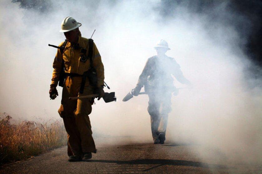 Firefighters make progress on containing Monrovia brush fire