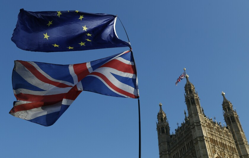 "FILE - In this Wednesday, Feb. 27, 2019 file photo the flag of the European Union and the British national flag are flown on poles during a demonstration by remain in the EU outside spporters the Palace of Westminster in London. It's more than four years since Britain voted to leave the European Union, and almost a year since Prime Minister Boris Johnson won an election by vowing to ""get Brexit done."" Spoiler alert: It is not done. As negotiators from the two sides hunker down for their final weeks of talks on an elusive trade agreement, Britain and the EU still don't know whether they will begin 2021 with an organized partnership or a messy rivalry. (AP Photo/Alastair Grant, File)"