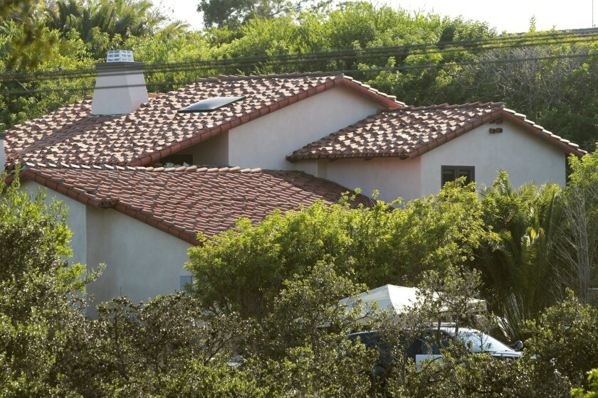 The house on Via de la Valle in Rancho Santa Fe where two women and a girl were found dead on Monday.