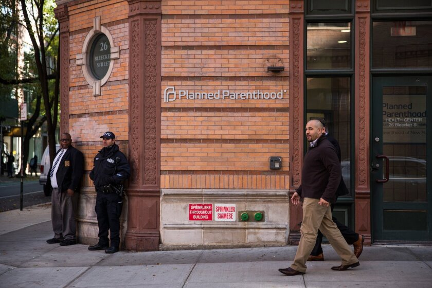 A police officer from NYPD's counterterrorism department stands guard outside a Planned Parenthood clinic in New York City on Nov. 30.