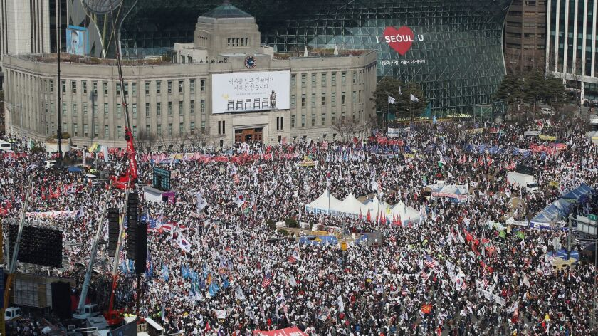 Thousands of South Koreans rally March 4 in Seoul in support of embattled President Park Geun-hye. A court is expected to rule this week on whether she should be removed from office.