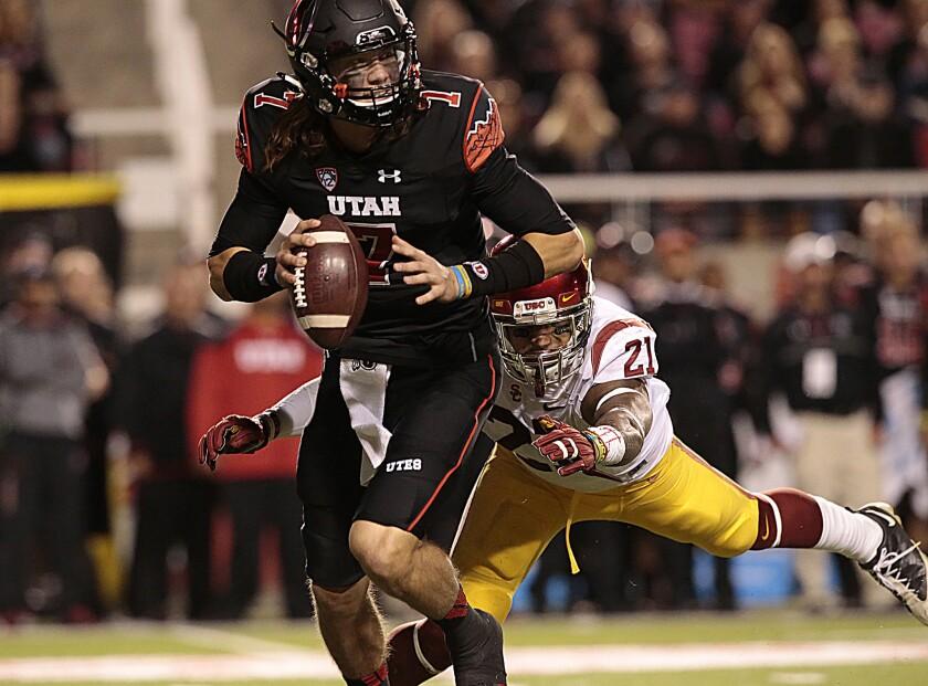Su'a Cravens sacks Utah quarterback Travis Wilson in October.
