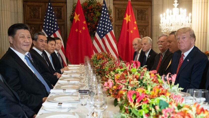 US President Donald Trump, right, and members of his delegation have dinner with China's President Xi Jinping, left, and Chinese government representatives, at the end of the G20 Leaders' Summit in Buenos Aires.