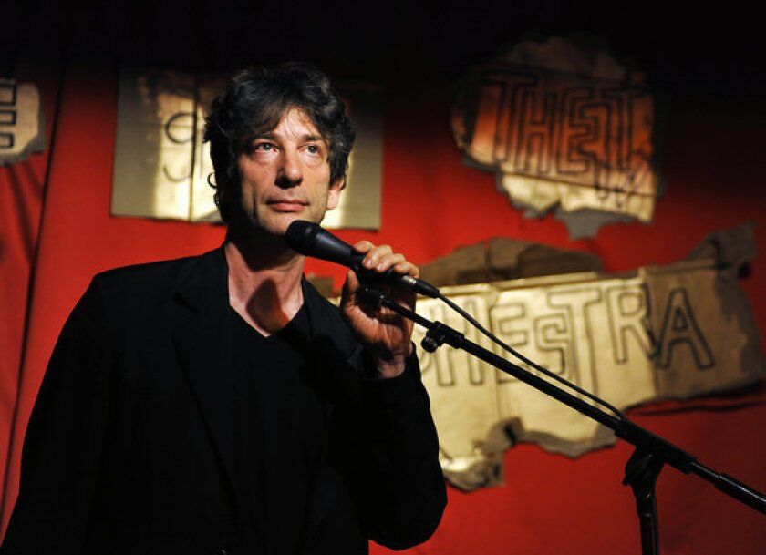 Neil Gaiman on stage as part of a performance by his wife, musician Amanda Palmer.