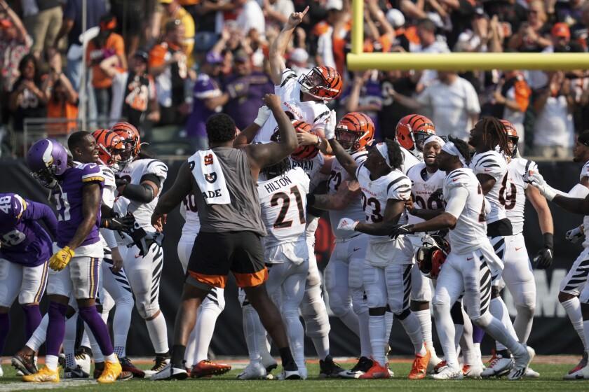 Cincinnati Bengals kicker Evan McPherson (2) is hoisted atop teammates' shoulders after he made a winning field goal to best the Minnesota Vikings in overtime of an NFL football game Sunday, Sept. 12, 2021, in Cincinnati. (Andrew Souffle/Star Tribune via AP)