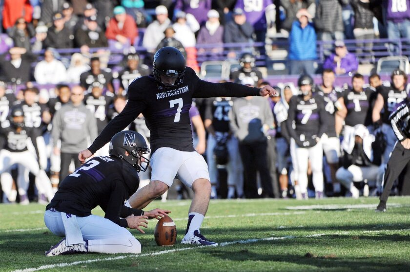 Northwestern place kicker Jack Mithchell (7) kicks the game-winning field goal in the closing seconds of the second half of an NCAA college football game against Penn State in Evanston, Ill.,  Saturday, Nov. 7, 2015.  Northwestern beat Penn State 23-21. (AP Photo/Matt Marton)