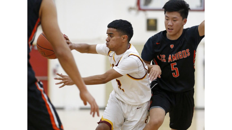Photo Gallery: Los Amigos vs. Estancia in boys' basketball