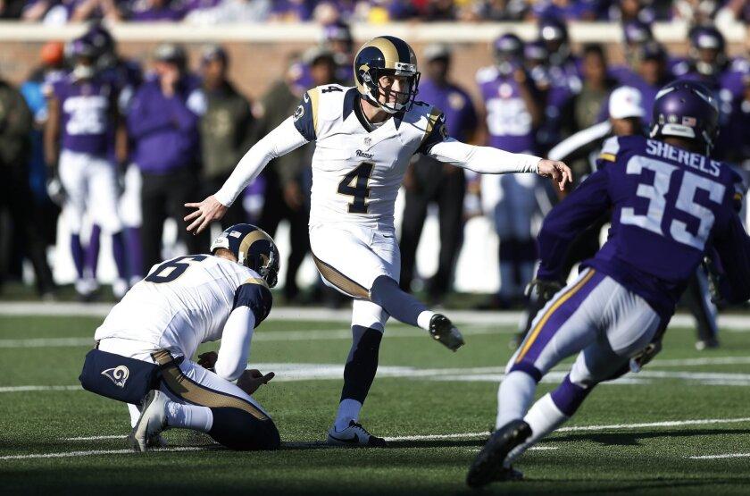 St. Louis Rams kicker Greg Zuerlein (4) kicks a field goal during the first half of an NFL football game against the Minnesota Vikings, Sunday, Nov. 8, 2015, in Minneapolis. (AP Photo/Jim Mone)