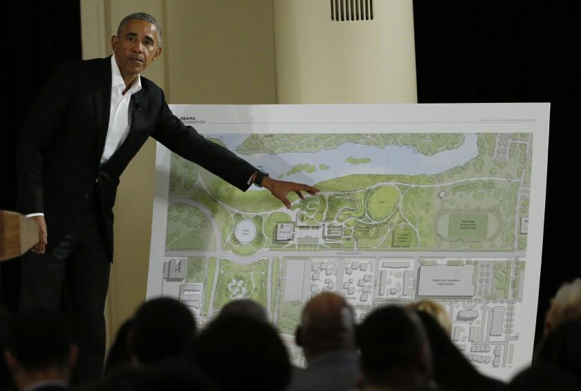 Former President Obama gesturing at blueprint