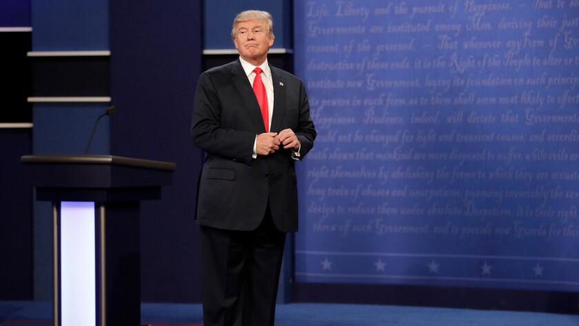 Republican presidential nominee Donald Trump stands on stage after the third presidential debate at UNLV in Las Vegas on Oct. 19.
