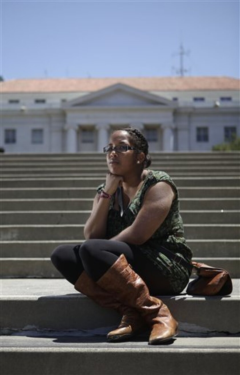 University of California Berkeley student Dior Sweeney poses for a photograph on the campus in Berkeley, Calif., Friday, July 1, 2011. California college students could see bigger tuition bills but fewer courses and services after lawmakers passed a state budget that slashes spending on higher education. (AP Photo/Jeff Chiu)