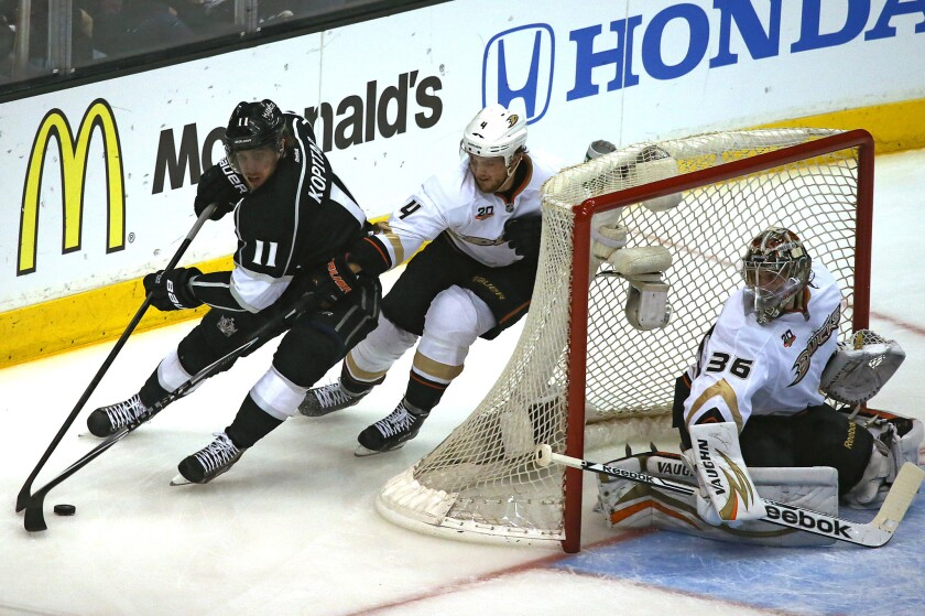 Kings center Anze Kopitar, shown trying to work around the defense of Ducks defenseman Cam Fowler and goalie John Gibson on May 10, might be playing even better than when he led the league in playoff scoring when the Kings won the Stanley Cup in 2012.