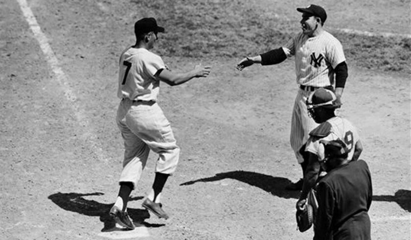 Cleveland's Al Rosen is greeted at home plate by the Yankees' Yogi Berra after Rosen hit his second home run for the AL in the 1954 All-Star Game.
