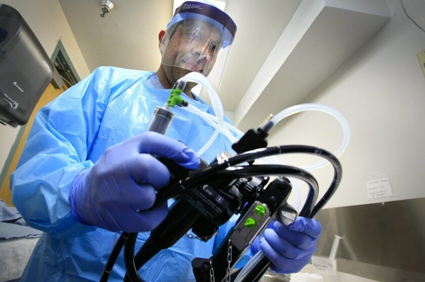 Rafael Millan Jr. cleans and sanitizes an endoscope at Paradise Valley Hospital in National City, which had one of the county's best rates of preventable hospital errors. / photo by Howard Lipin * U-T