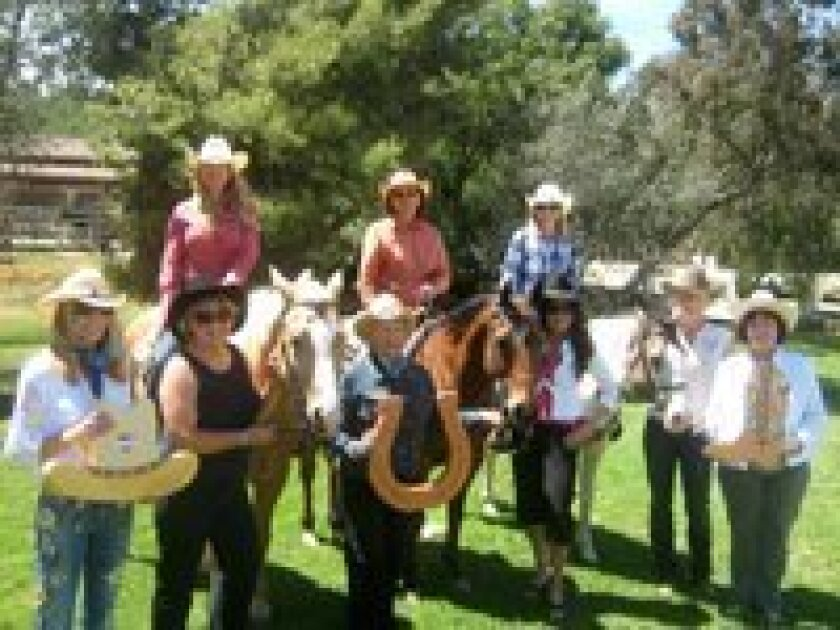 """Volunteers of Friends of San Pasqual Academy are getting ready for the """"Teens, Jeans, and Dreams Team Penning"""" event, which will have many local riders competing in this fun competition.  A Silent Auction and Wine Reception will also be held and the proceeds benefit the 150 foster teens of San Pasq"""