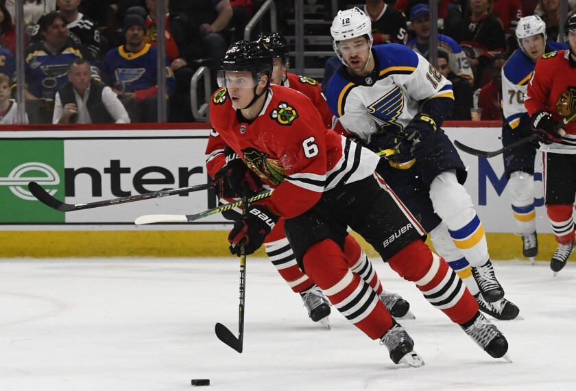 Chicago Blackhawks defenseman Olli Maatta moves the puck away from St. Louis Blues left wing Zach Sanford.